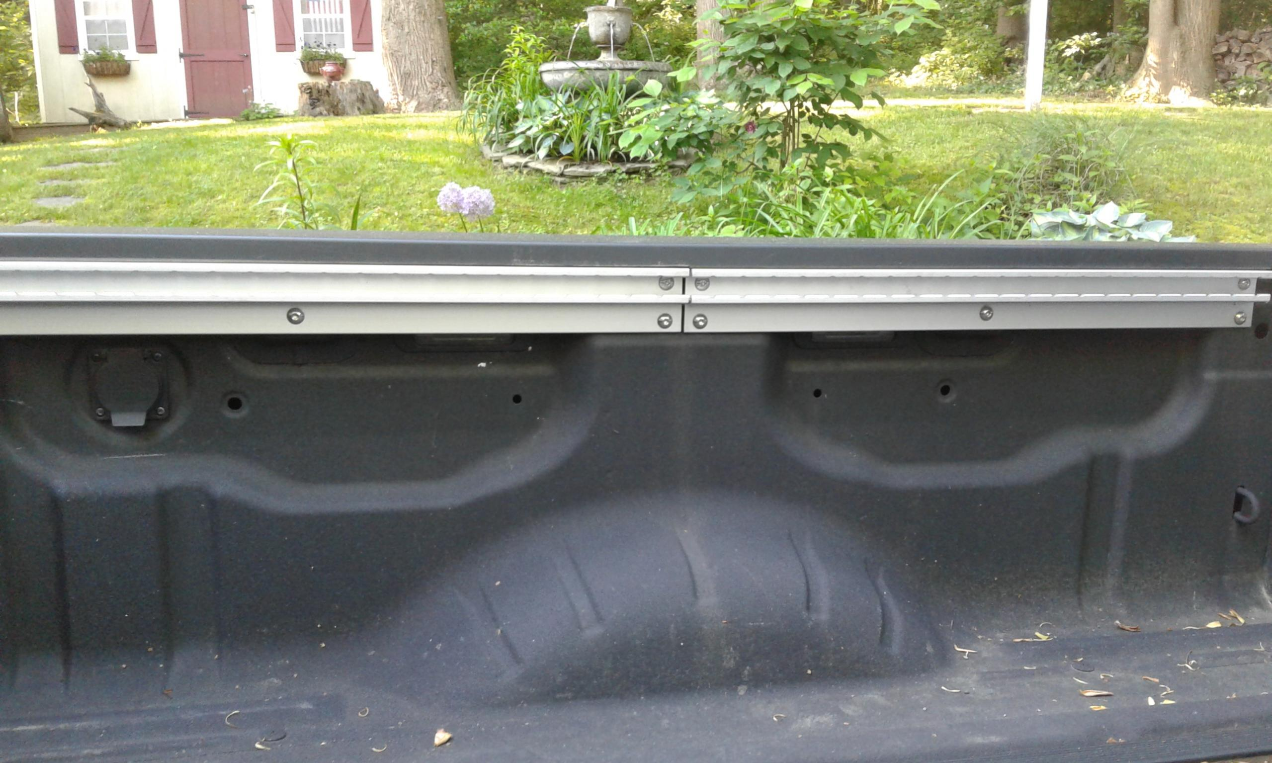 What are the round, open holes in the sides of my truck bed?-20190522_075321.jpg