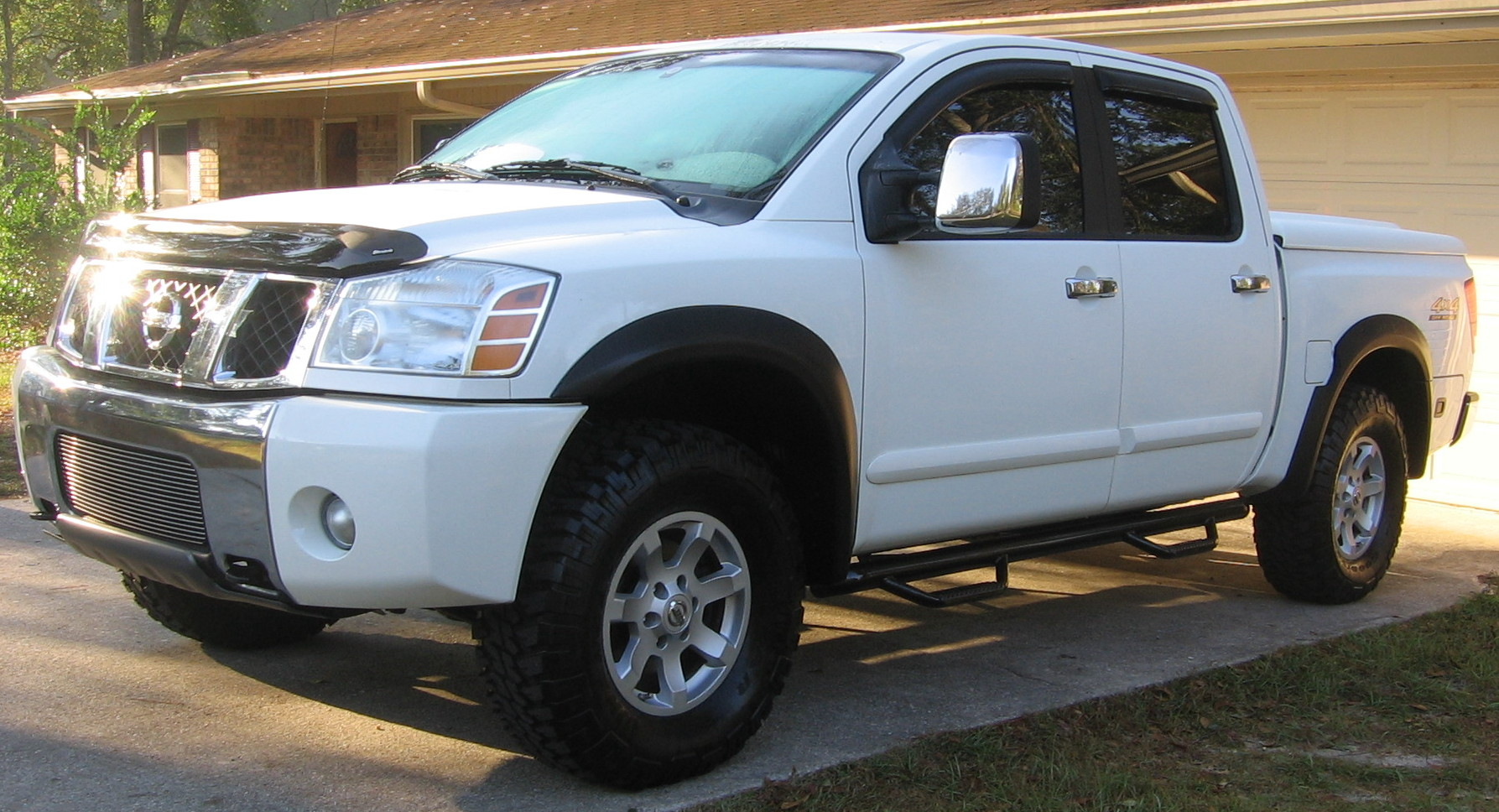 N fab and bushwacker flares on white nissan titan forum n fab and bushwacker flares on white img0599cropg vanachro Image collections