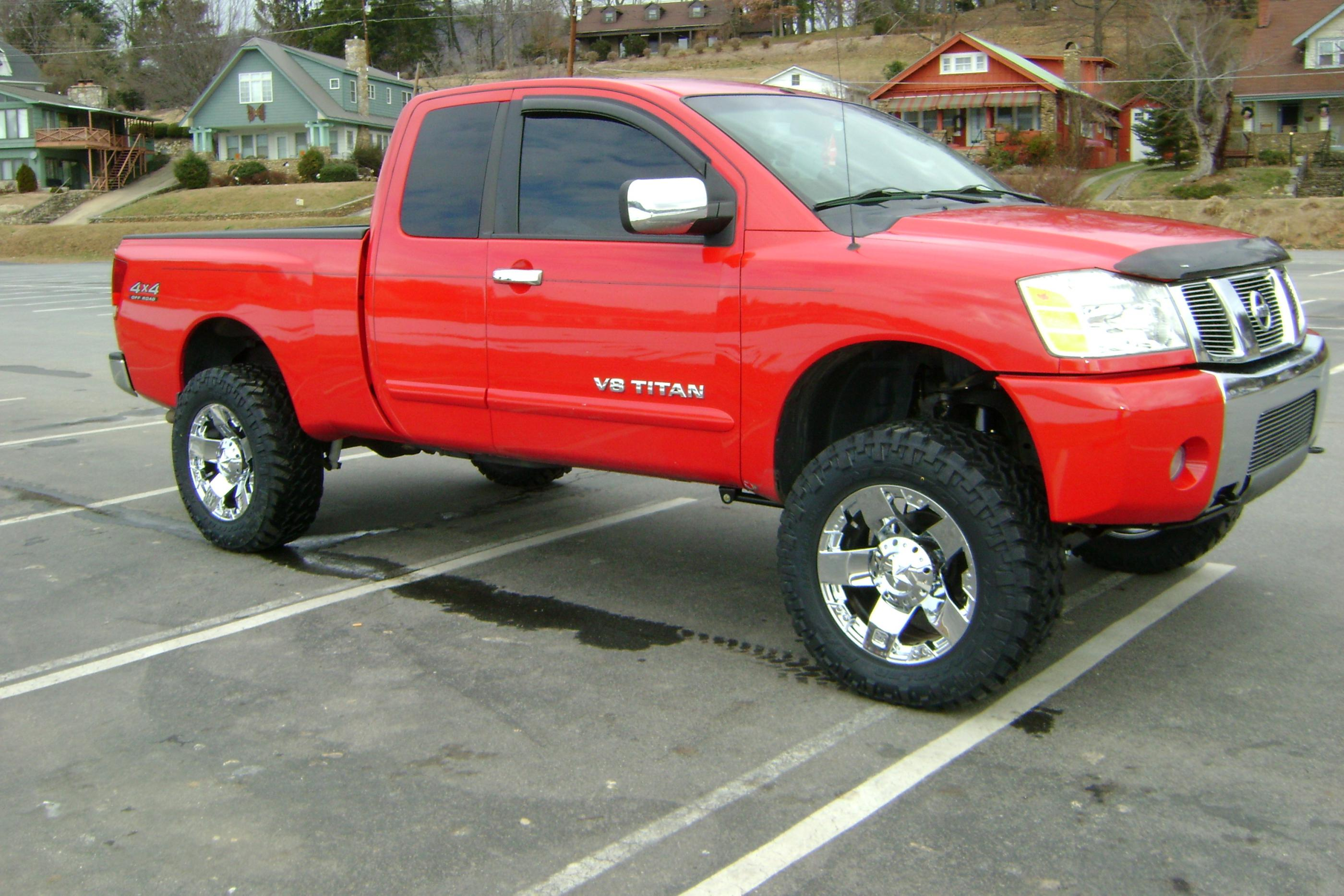 who has a red titan with aftermarket wheels
