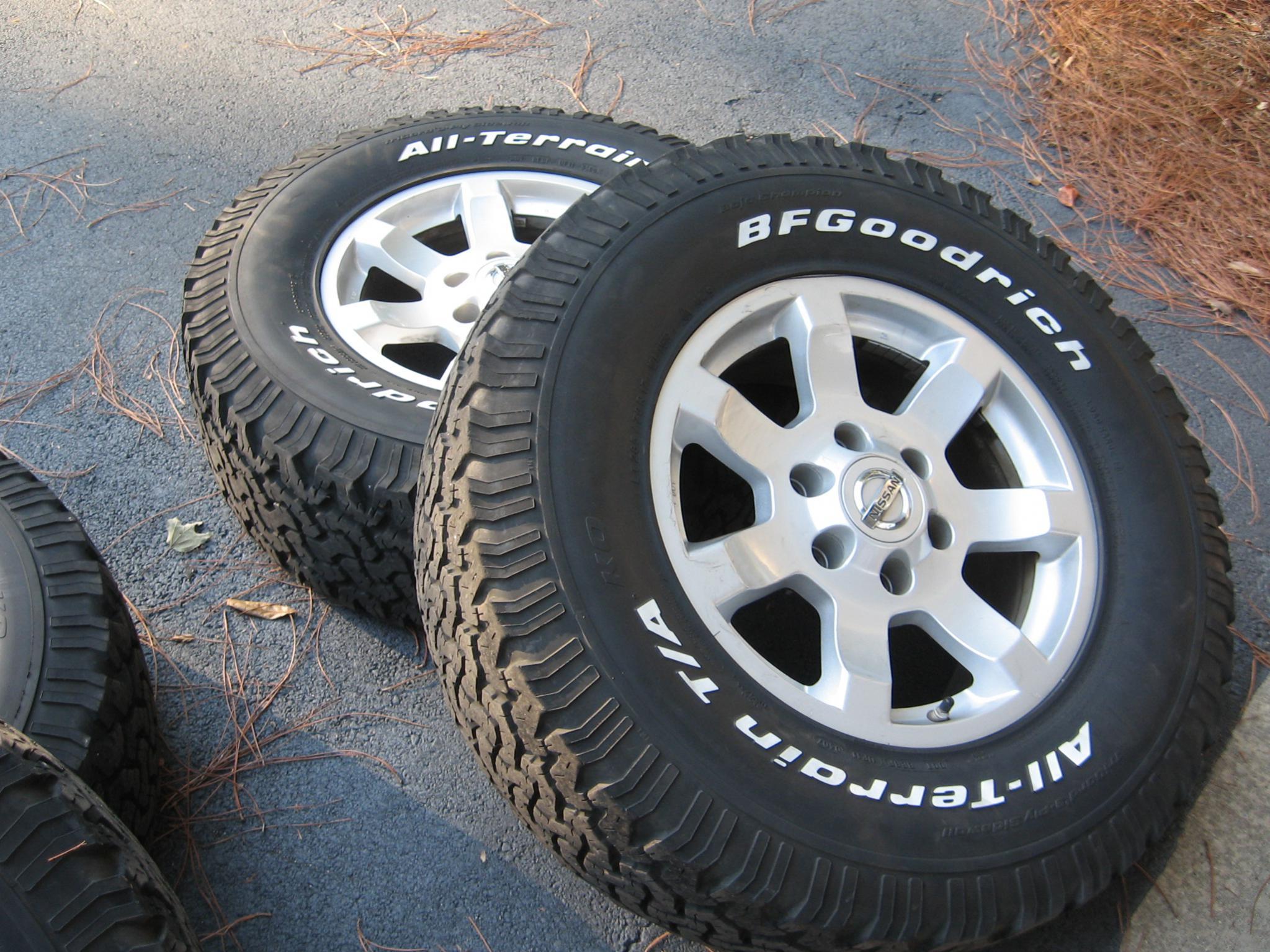 285 70 17 BF Goodrich All Terrain T A and Stock Rims Nissan Titan